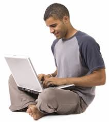 Man on floor using laptop