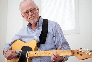 Getty_rf_photo_of_man_playing_guitar