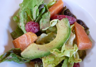 Fruit and greens w papaya seed dressing
